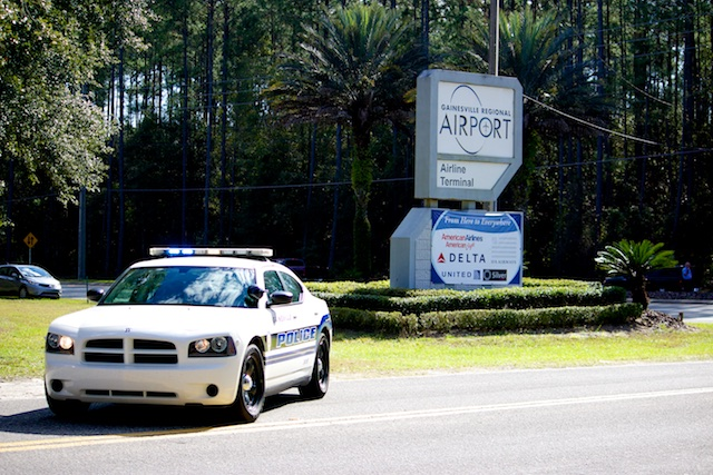 A GPD Patrol Car, a Dodge Charger, at the entrance to the Gainesville Airport
