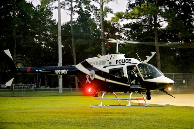 The GPD Joint Aviation Unit helicopter landing in a field