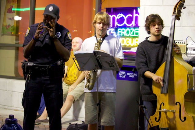 The GPD Downtown Unit, an Officer playing a musical instrument at Bo Diddley Plaza