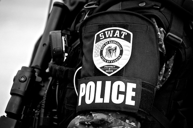 A close up of a GPD SWAT Team member's left shoulder, displaying his badge.